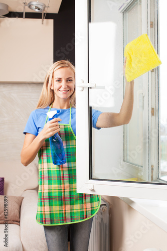 Woman washing window