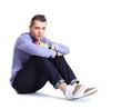 Flirtatious man sitting on the floor