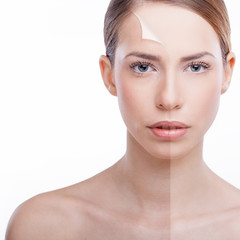 Beautiful woman presenting 'peeling back' anti-aging concept.