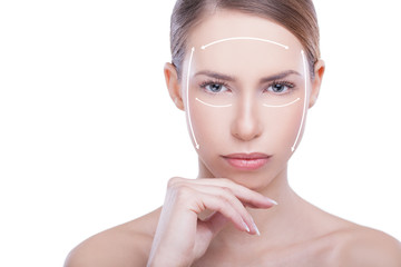 Beautiful woman with facial treatment arrows. Plastic surgery co