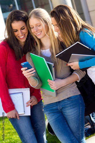 Students having fun with smartphones after class