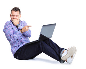 happy man working on laptop in casuals. Concept communication.