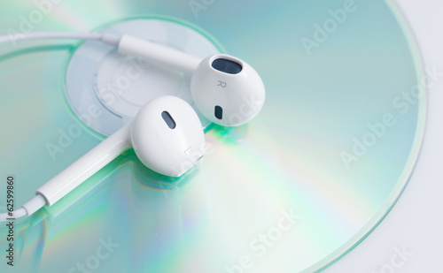 White earphone on music dvd