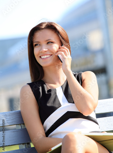 Young businesswoman having a conversation using a smartphone