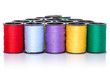 Colorful bobbins on white