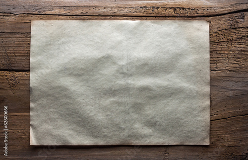 paper on wooden background