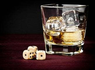 dice near whiskey glass, concept of game