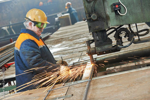 industry worker at spot welding machine