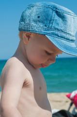 Little boy in denim cap