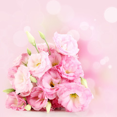 Bouquet of eustoma flowers on bright background