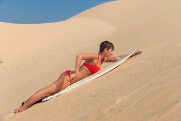 beautiful young woman surfer girl in bikini