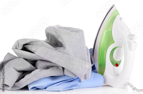 Iron with shirts isolated on white