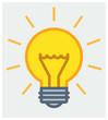 Shining yellow light bulb vector icon