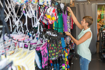 beautiful smiling woman shopping in retail store