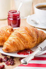 Croissants with raspberry jam and coffee.