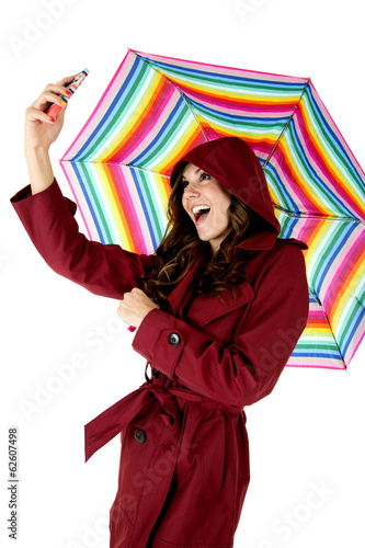Attractive female model taking selfie holding colorful rainbow u