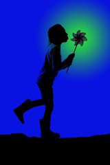 silhouette of a girl blowing a toy pinwheel with a striking blue