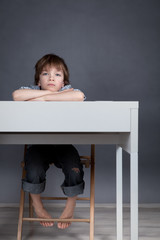 Thinking student sitting at desk
