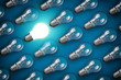 Idea concept with light bulbs on blue background