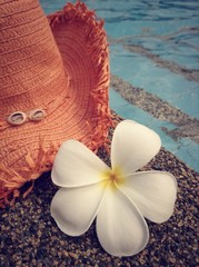 Hat, flower and poolside