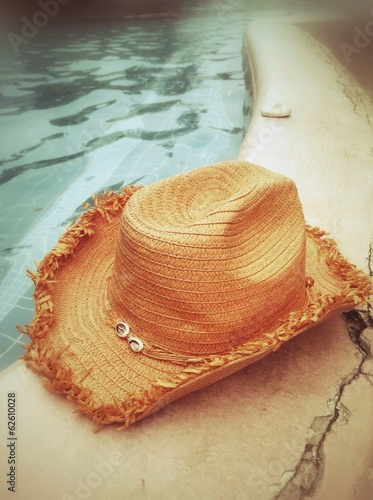 Hat and poolside