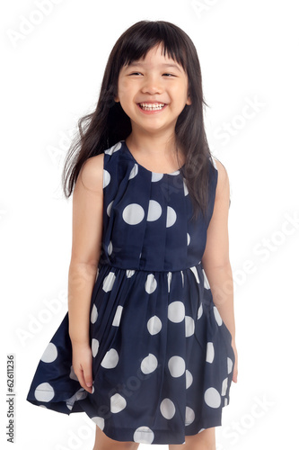 Happy little girl laughing isolated