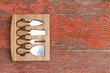 Set of cheese cutters in a fitted wooden block