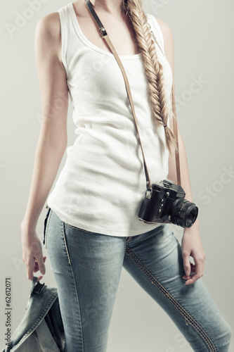 girl posing with old photo camera