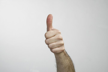 Hand with thumb up isolated on white background. Ok sign by man
