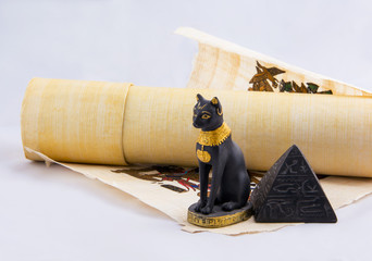 Egyptian cat, a pyramid and papyrus - souvenirs from travels