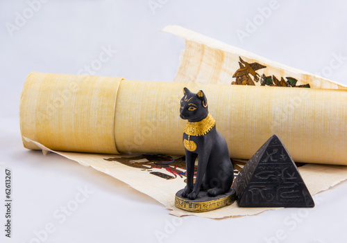 Fotobehang Egypte Egyptian cat, a pyramid and papyrus - souvenirs from travels