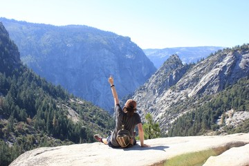 Girl hiking to the top of Yosemite National Park in summer