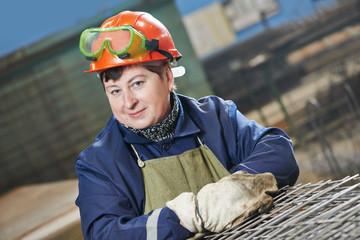 industry worker at spot welding machine