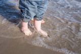 Baby feet in water at beach