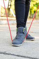 Feet of a woman athlete with a torsion rope