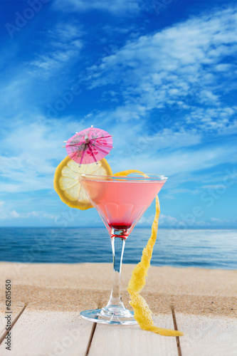 Fresh pink cocktail at the beach