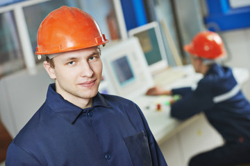 Happy industry worker at factory