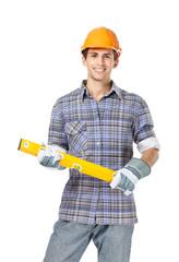 Portrait of foreman in range helmet handing level