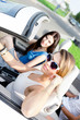 Two girls drive the car