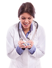 Nurse smiling on pills