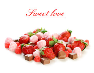 strawberries,candy and chocolates on white background