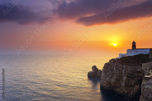 Lighthouse of Cabo Sao Vicente, Sagres, Portugal at Sunset .
