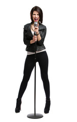 Full-length portrait of rock singer keeping static mic, isolated
