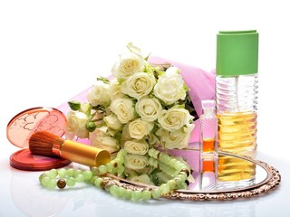 perfumes, cosmetics and a bouquet of flowers in still life