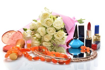jewelry, perfumes, cosmetics and a bouquet of flowers