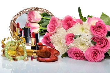 jewelry, cosmetics and a bouquet of flowers in still life
