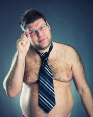 Serious shirtless man weard tie and glasses