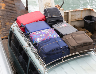 Suitcases on the roof of a car