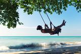 Fototapety Female on swings in Thailand