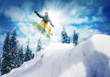 Snowboarder jump against sky and trees